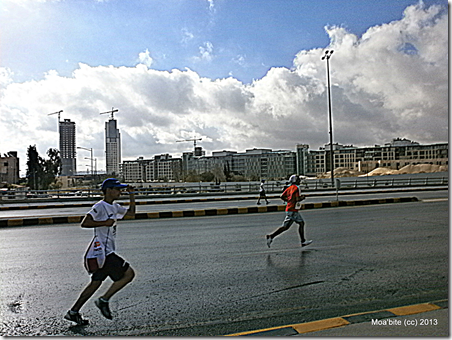 Runners in front of the Abdali project.