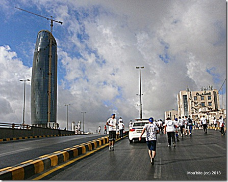 Runners and a police car in Abdali area. I took it in the street between the Headquarters of Umniah Company and the Abdali project.