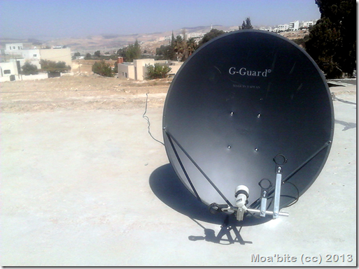 My G-Guard satellite dish. It costed me, with insatllation fees, 28 JD ($39.48). In the far backgroud at the left appears the Baqa'a refugee camp. I wanted to show the camp in my photo. This is why I did not put the satellite in the center of the photo.