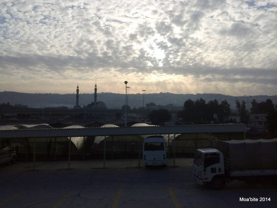 Before I enter to wear my shirt and start working, a view of the dawn at 7:53 AM, above a mosque in Al-Baqa Refugee Camp, Amman, Jordan.
