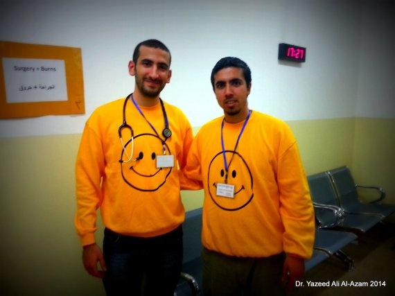 Dr. Yazeed Ali Al-Azam and I with our very beautiful and comfortable operation smile shirts.